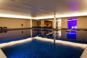 The swimming pool at or near Lincoln Plaza London, Curio Collection By Hilton