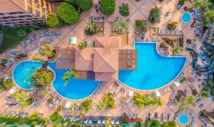 A view of the pool at H10 Costa Adeje Palace or nearby