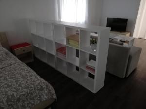 TV a/nebo společenská místnost v ubytování Vita Style
