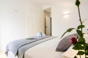 A bed or beds in a room at Casa Adro