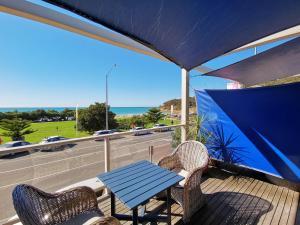 A balcony or terrace at The Sandridge Motel