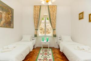 A bed or beds in a room at Apartment Villa Ahava