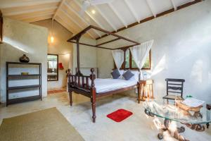 A bed or beds in a room at Namaste Jungle - A Boutique Homestay