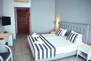 Ένα ή περισσότερα κρεβάτια σε δωμάτιο στο Hotel Akti Ouranoupoli Beach Resort