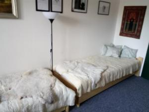 A bed or beds in a room at Penzion Bázum