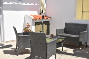A patio or other outdoor area at Maison D'Almoinha
