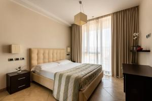 A bed or beds in a room at ApartHotel Anghel