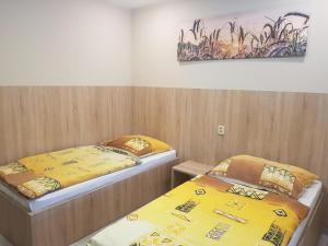 Postel nebo postele na pokoji v ubytování Penzion Hudebka