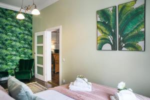 Postel nebo postele na pokoji v ubytování Mr.Elegant - Old Town Luxurious Apartment