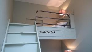 A bunk bed or bunk beds in a room at Glendower Guest Apartments