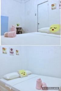 A bed or beds in a room at Ais'G Homestay