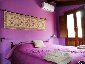A bed or beds in a room at Casa Susanna