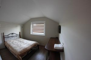 A bed or beds in a room at Elena