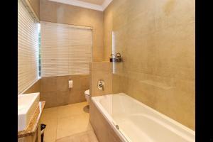 A bathroom at 6 On Acacia
