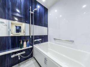 A bathroom at Hotel Gracery Osaka Namba