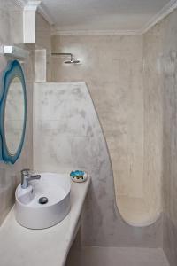 Kylpyhuone majoituspaikassa Roula Villa Studios & Apartments
