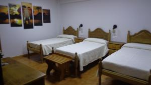 A bed or beds in a room at Hotel Vasco Da Gama
