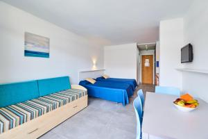 A bed or beds in a room at Inter 2