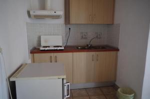 A kitchen or kitchenette at Esperos Hotel