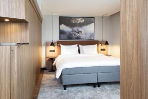 A bed or beds in a room at Radisson Blu Airport Hotel, Oslo Gardermoen