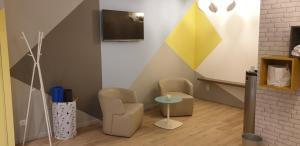 A seating area at Mercure Marseille Centre Vieux Port