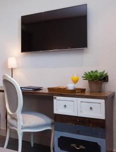 A television and/or entertainment center at Hotel Diana