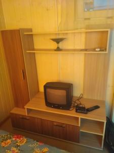 Телевизор и/или развлекательный центр в  Гостевой Дом Виктория на Морской