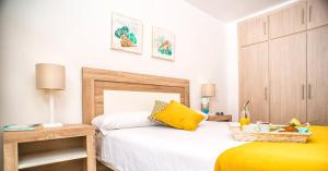 A bed or beds in a room at Ona Suites Salou