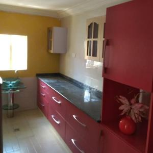 A kitchen or kitchenette at KH Lodge Abuja