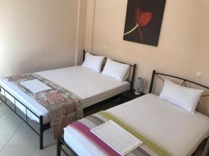 Ένα ή περισσότερα κρεβάτια σε δωμάτιο στο Sea View Villa