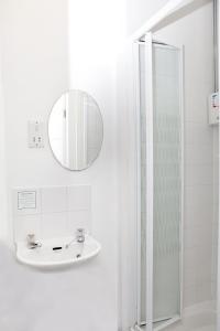 A bathroom at ATZ&H INN