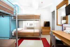 A bunk bed or bunk beds in a room at West Side YMCA