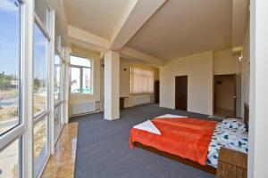 Кровать или кровати в номере Спорт Отель