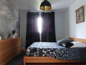 Un ou plusieurs lits dans un hébergement de l'établissement B&B Les Hauts d'Ornans