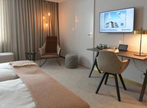 Телевизор и/или развлекательный центр в Kongress Hotel Davos