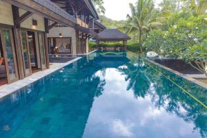 The swimming pool at or near Kudat Riviera Exclusive Beach Villas