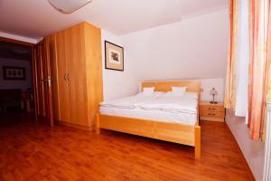 Postel nebo postele na pokoji v ubytování Penzion na Ostrově