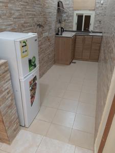A cozinha ou cozinha compacta de Al Masarah Furnished Units