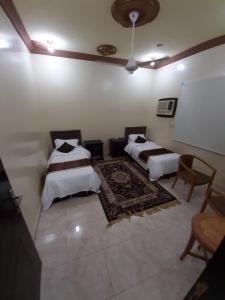 Cama ou camas em um quarto em Al Masarah Furnished Units