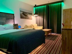 A bed or beds in a room at TheWaterfrontLodges