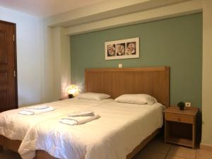 A bed or beds in a room at Mirtilos Studios & Apartments
