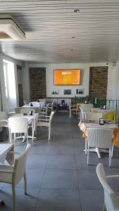 A restaurant or other place to eat at B&B Il Porto Vecchio