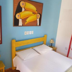 A bed or beds in a room at Pousada Bela Paraty