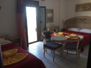 Ένα ή περισσότερα κρεβάτια σε δωμάτιο στο Alexander Beach Hotel