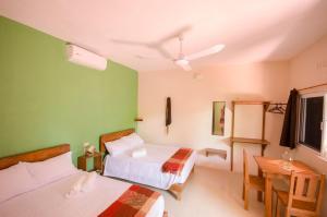 Un ou plusieurs lits dans un hébergement de l'établissement Casa Almendro