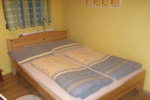 A bed or beds in a room at Czanadomb Vendégház