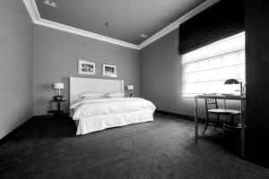 Cama o camas de una habitación en Hotel Odette en Ville