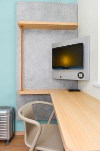 A television and/or entertainment centre at ibis Budget Charleroi Airport
