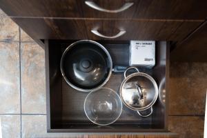 A kitchen or kitchenette at Уютные Апартаменты в самом центре Орджоникидзе 33