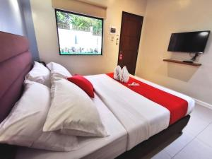 A bed or beds in a room at Charms Hotel